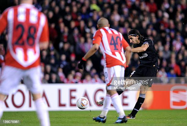 Mehmet Topal of Valencia CF scores the opening goal during the UEFA Europa League Round of 32 First leg match between Stoke City and Valencia CF at...