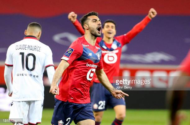Mehmet Zeki Celik of Lille celebrates his goal with Benjamin Andre in the back during the Ligue 1 match between Lille OSC and OGC Nice at Stade...
