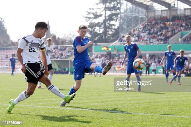MehmetCan Aydin of Germany U17 is challenged by Isak Bergmann Johannesson of Iceland U17 during the UEFA Elite Round match between Germany U17 and...