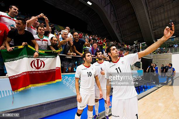 Mehran Alighadr Ahmad Esmaeilpour and Mohammad Taheri of Iran take a selfie with supporters after the FIFA Futsal World Cup SemiFinal match between...