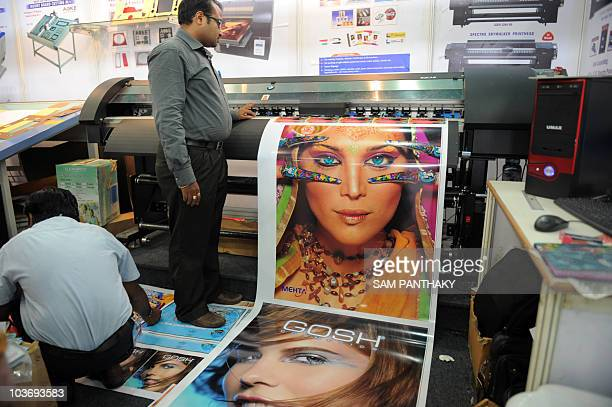 Mehta Cad Cam Systems Pvt Ltd Harsh Parel monitors a photo printing machine at his stall on the second day of the three day Photo Video Fair 2010 in...