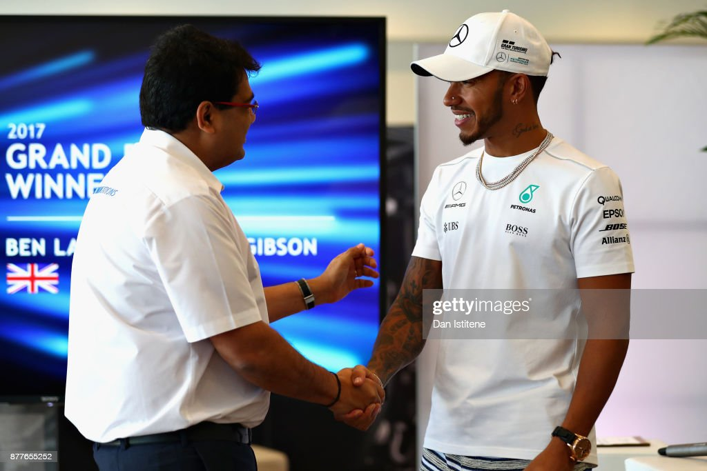Mehul Kapadia talks with Lewis Hamilton of Great Britain and Mercedes GP during the F1 Connectivity Innovation prize giving at Yas Marina Circuit on November 23, 2017 in Abu Dhabi, United Arab Emirates.