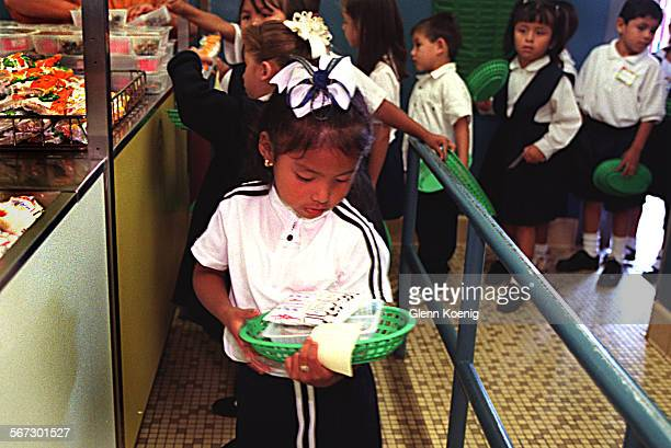MEHungerLunch0707GK–Children in line for lunch on the first day of school at Roosevelt Elementary School in Santa Ana About 98 per cent of the...