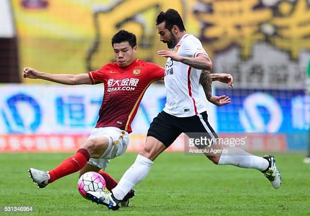 Mei Fang of Guangzhou Evergrande in action against Ezequiel Lavezzi of Hebei China Fortune FC during the China Super League match between Guangzhou...