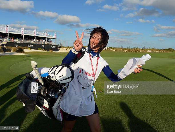 Mei Inui who caddied for Hideki Matsuyama of Japan flashes a victory sign after the final round of the Hero World Challenge at Albany course on...