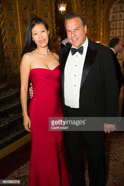 Mei Sze and Jeff Greene attend the 58th International Red Cross Ball at The MaraLargo Club on February 28 2015 in Palm Beach Florida
