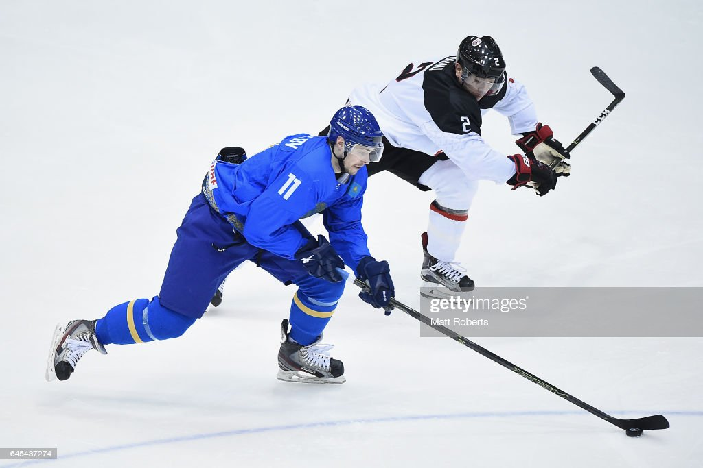 Mei Ushu of Japan and Ilya Kovzalov of Kazakhstan battle for the puck in the men's ice hockey match between Japan and Kazakhstan on day nine of the 2017 Sapporo Asian Winter Games at Tsukisama Gymnasium on February 26, 2017 in Sapporo, Japan.
