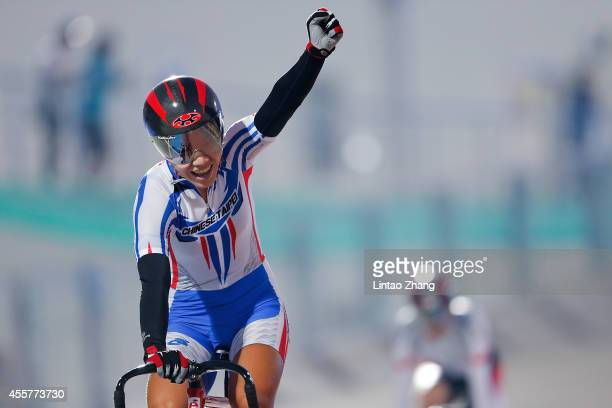 Mei Yu Hsiao of Chinese Taipei celebrates after the Cycling Track Women's Team Sprint Finals during the 2014 Asian Games at Incheon International...