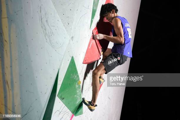 Meichi Narasaki of Japan competes in the Bouldering during Combined Men's Final on day eleven of the IFSC Climbing World Championships at the Esforta...
