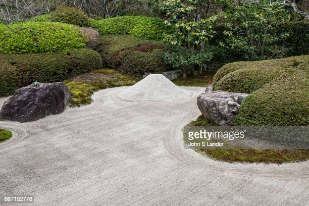 Meigetsuin Zen Garden The karesansui zen garden of raked sand rocks and plants at Meigetsuin Temple Garden represents legendary Mount Shumi or Sumeru...