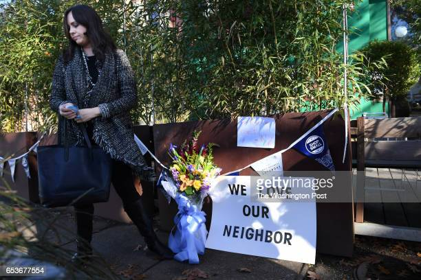 Meighan Stone leaves flowers and signs outside Comet Ping Pong on Monday Decmmber 05 2016 in Washington DC A man identified as Edgar Maddison Welch...