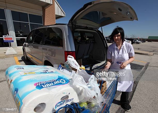 Meijer grocery express personal shopper, Katie Dunow, loads groceries for Kathy Green in Geneva, Illinois, on Friday, March 26, 2010.