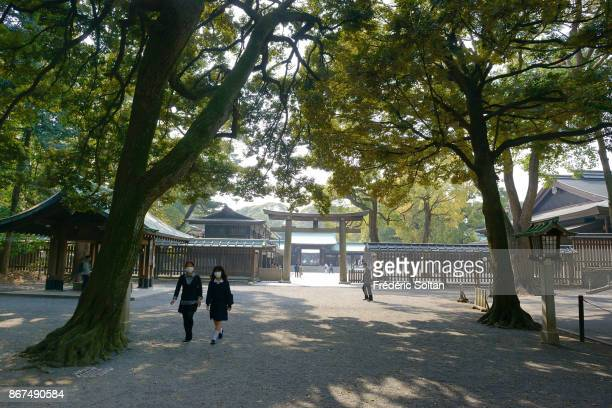 Meiji Imperial Shrine in Tokyo Family going to the Meiji Imperial Shrine located in Shibuya and dedicated to the deified spirits of Emperor Meiji and...
