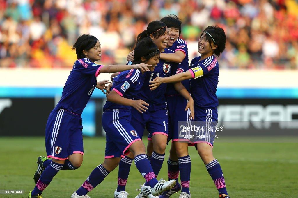 Meika Nishida #11 of Japan celebrate with her tem mats after scoring the opening goal during the FIFA U-17 Women's World Cup 2014 final match between Japan and Spain at Estadio Nacional on April 4, 2014 in San Jose, Costa Rica.