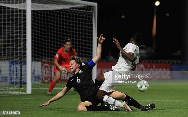 Meikayla Moore of New Zealand tackles Sandra OwusuAnsah of Ghana during the FIFA U20 Women's World Cup Papua New Guinea 2016 Group C match between...
