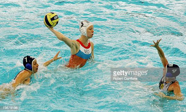 Meike Cabout of Netherlands shoots at goal as Yuliya Znamenskaya of Kazakhstan attempts to stop her in the Women's Preliminary Round Group C Water...