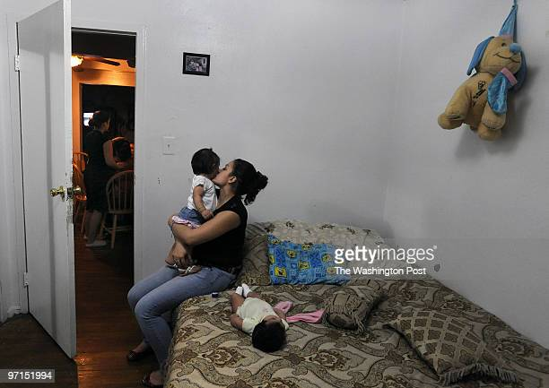 April 26 2009 PHOTOGRAPHER Carol Guzy Langley Park MD SECOND GENERATION LATINOS Edelmira Chavez 15 holds her 1 year old daughter Ashley as her sister...