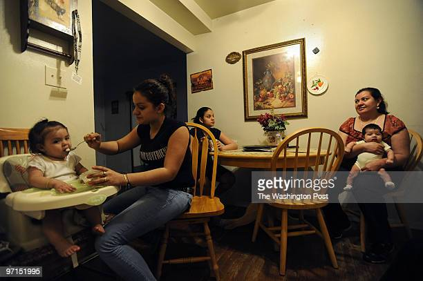 April 26 2009 PHOTOGRAPHER Carol Guzy Langley Park MD SECOND GENERATION LATINOS Edelmira Chavez 15 feeds her 1 year old girl named Ashley as her...