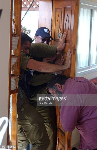 Meir Cohen tries to prevent IDF soldiers enter his home in the Jewish settlement of Neve Dekalim part of the Gush Katif settlement bloc Gaza Strip...