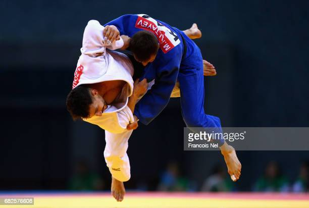 Meirzhan Kaltayev of Kazaksthan and Houd Zourdani of Algeria compete in the Men's Judo -66 kg event during day two of Baku 2017 - 4th Islamic...