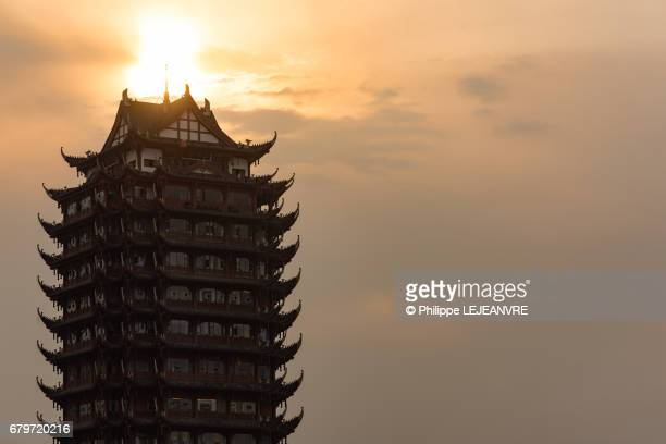 Meishan  - YuanJingLou building against sun