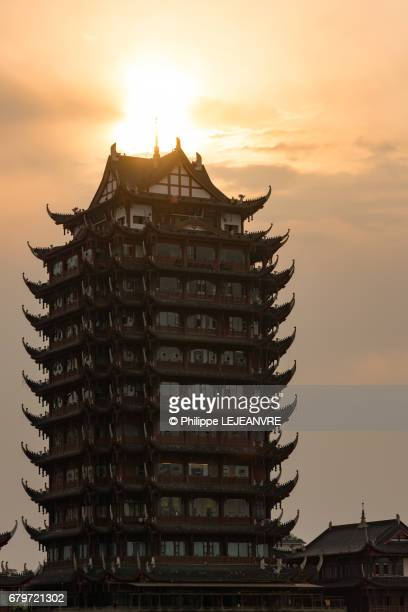 Meishan  - YuanJingLou building against sun - Vertical