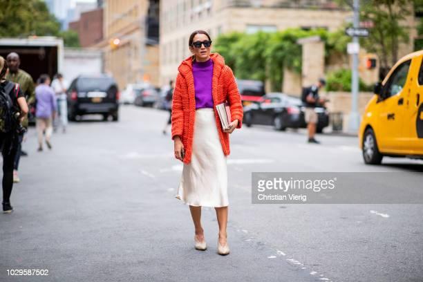 Meital Katz wearing red teddy jacket silk skirt purple turtleneck seen outside Jonathan Simkhai during New York Fashion Week Spring/Summer 2019 on...