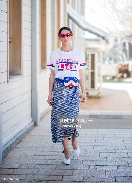 Meital Katz wearing white tshirt with Brooklyn printed metallic midi skirt Gucci fanny bag is seen during Tel Aviv Fashion Week on March 13 2018 in...