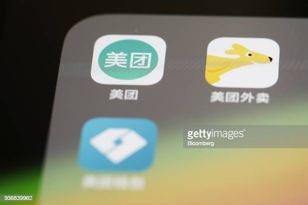 Meituan Dianping application icons Meituan clockwise from left Meituan Waimai and Meituan Wallet are displayed on an Apple Inc iPhone in an arranged...