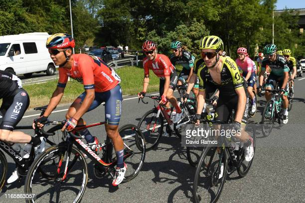 Meiyin Wang of China and Team BahrainMerida / Adam Yates of Great Britain and Team MitcheltonScott / Peloton / during the 39th Clásica Ciclista San...