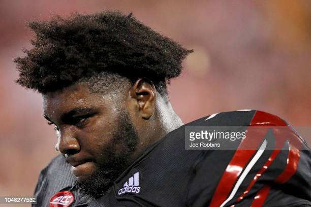 Mekhi Becton of the Louisville Cardinals reacts in the second half of the game against the Georgia Tech Yellow Jackets at Cardinal Stadium on October...