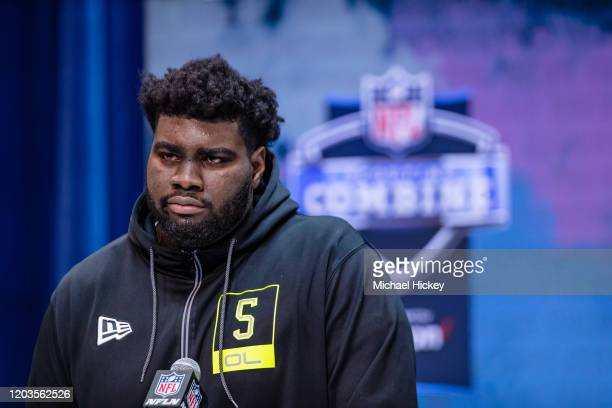 Mekhi Becton #OL05 of the Louisville Cardinals speaks to the media at the Indiana Convention Center on February 26 2020 in Indianapolis Indiana Mekhi...