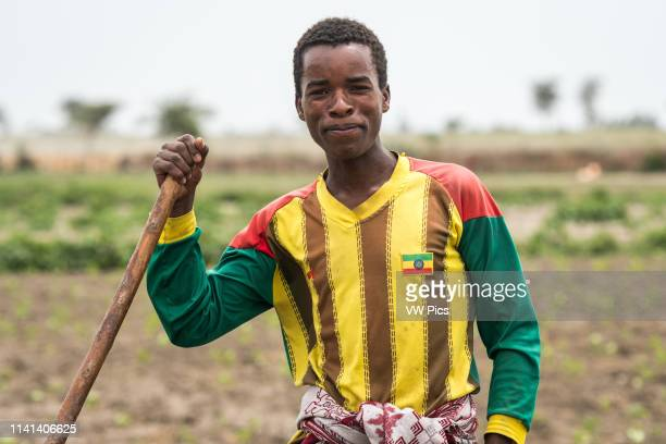 Meki Batu Ethiopia Young male worker tilling the ground at the Fruit and Vegetable Growers Cooperative in Meki Batu