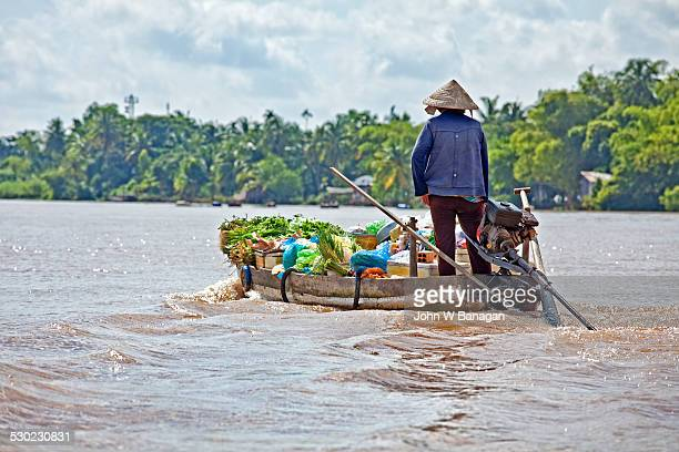 mekong delta, women in boats - south vietnam stock pictures, royalty-free photos & images