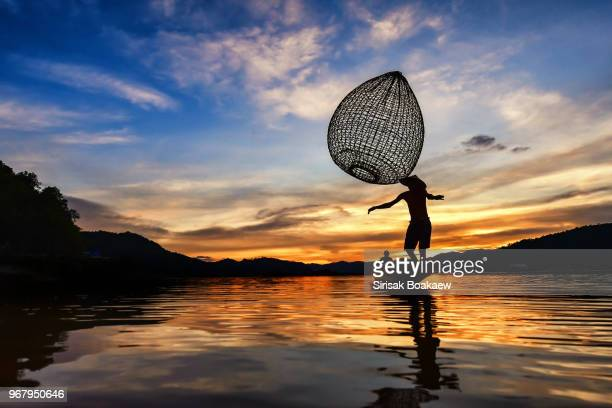 Mekong river fish sunset