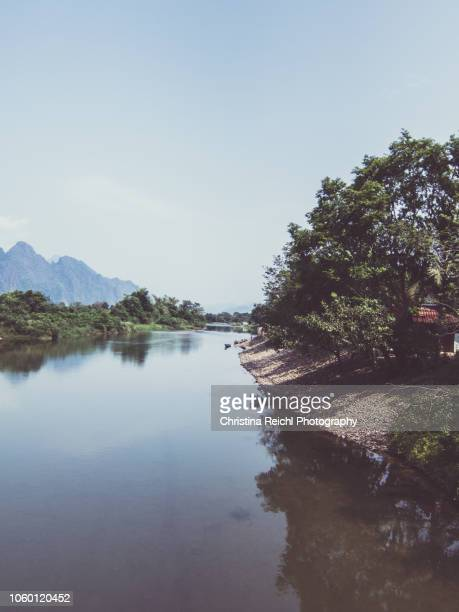 mekong river meandering through wonderfully scenic landscape in luang prabang - mekong delta stock pictures, royalty-free photos & images