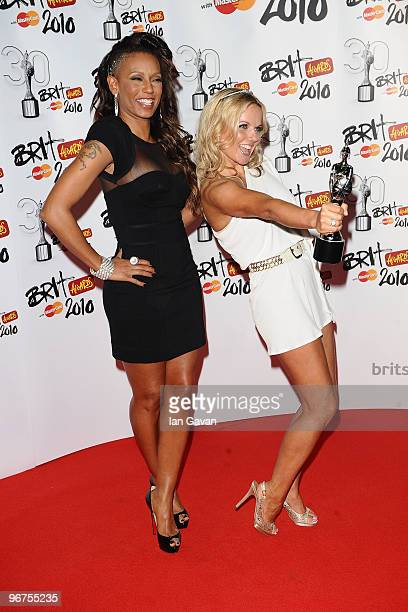 Mel B and Geri Halliwell of the Spice Girls pose with their award for 'Brits Performance of 30 Years' in the Awards room at The Brit Awards 2010 at...