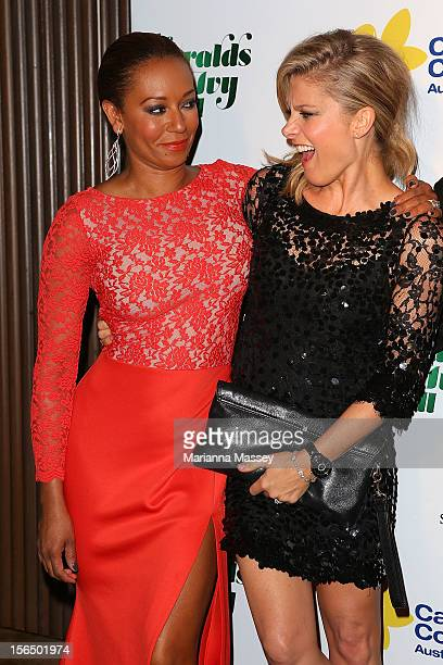 Mel B and Natalie Bassingthwaighte pretend to fight it out on the carpet as they arrive at The Ivy on November 16 2012 in Sydney Australia for the...
