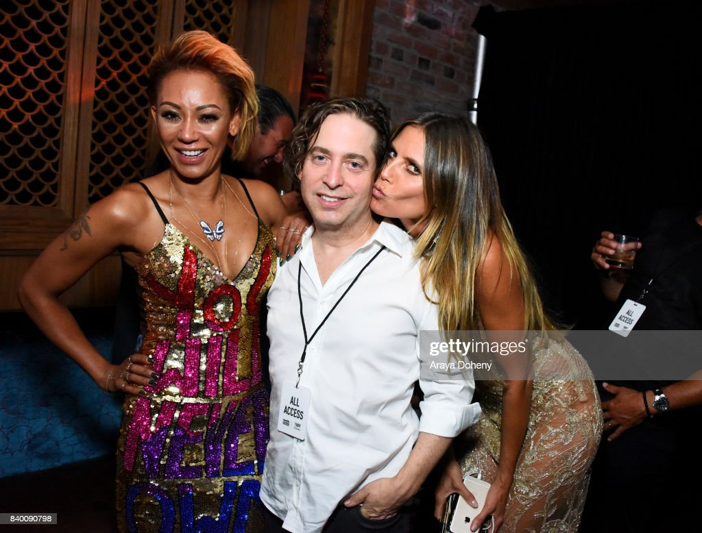 Mel B, Charlie Walk, and Heidi Klum attend the VMA after party hosted by Republic Records and Cadillac at TAO restaurant at the Dream Hotel on August 27, 2017 in Los Angeles, California.
