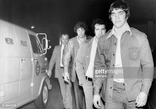 Mel Bridgman Joe Watson and Don Saleski of the Philadelphia Flyers turn themselves into police here today after warrants were issued for their...