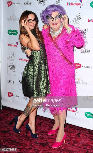 Mel C and Dame Edna Everage arriving at the Specsavers Spectacle Wearer of the Year Awards held at the Royal Opera House in London PRESS ASSOCIATION...