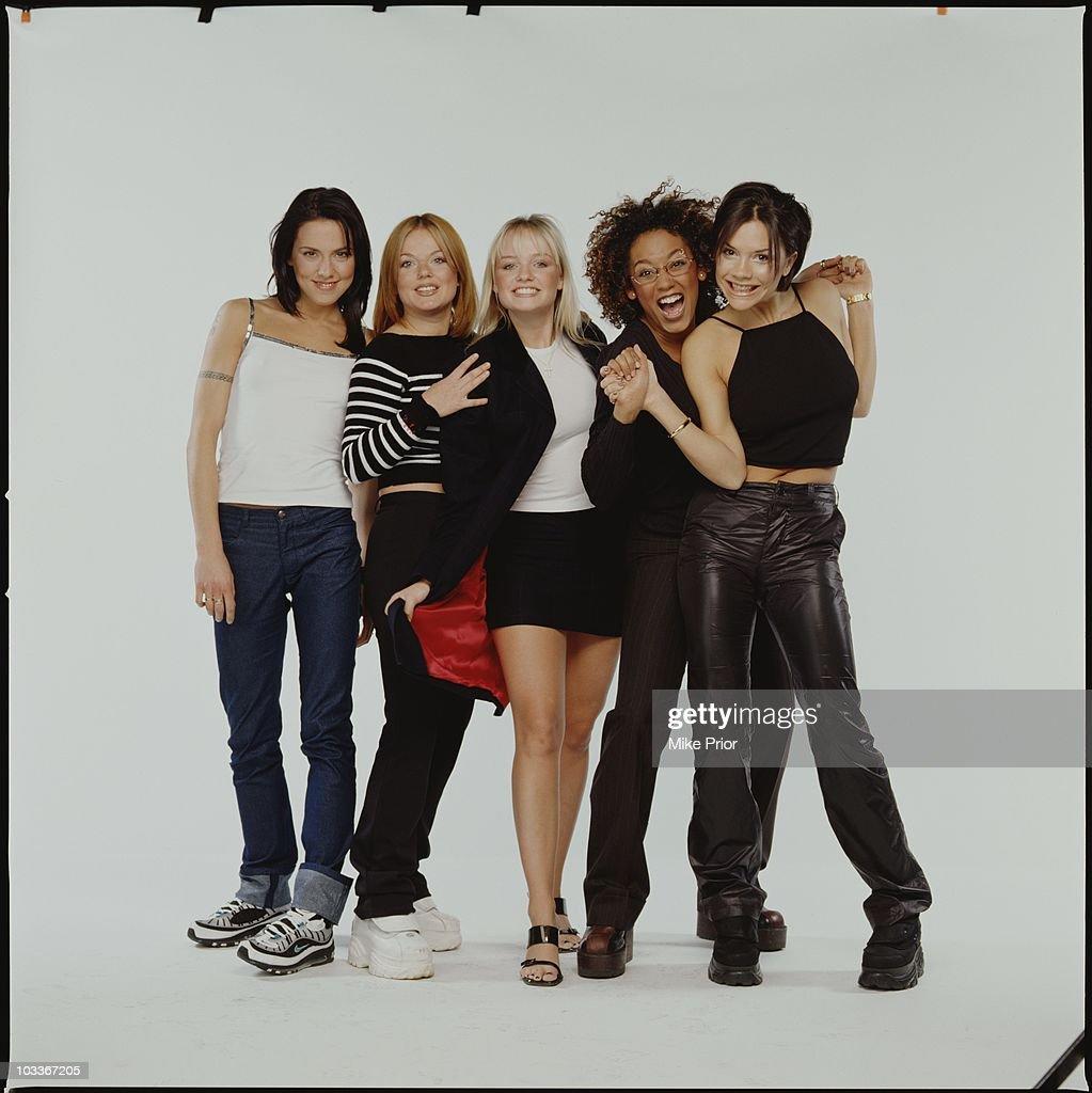 L-R Mel C (Melanie Chisolm), Geri Halliwell, Emma Bunton, Mel B (Melanie Brown), Victoria Adams of the Spice Girls pose for a studio group portrait in 1998 in Birmingham, United Kingdom.