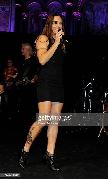 Mel C performs at the Queen AIDS Benefit in support of The Mercury Phoenix Trust at One Mayfair on September 5 2013 in London England