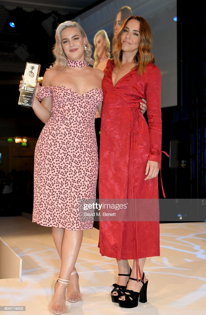 Mel C presents Anne-Marie with the Jack Daniels Best Newcomer Award at the Nordoff Robbins O2 Silver Clef Awards at The Grosvenor House Hotel on June 30, 2017 in London, England.