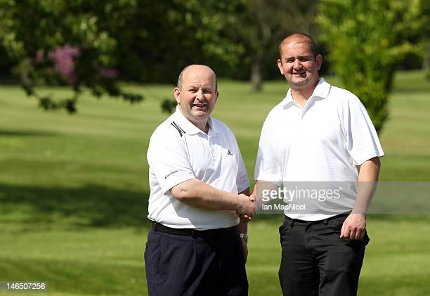 Mel Douglas and Gary Tyronney of Inverness Golf Club posse for photographs after winning the Virgin Atlantic PGA National Pro-Am Championship -...