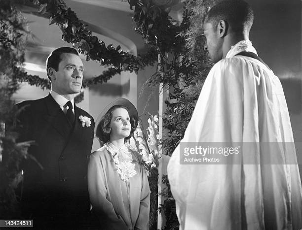 Mel Ferrer and Beatrice Pearson standing at the alter in a scene from the film 'Lost Boundaries' 1949