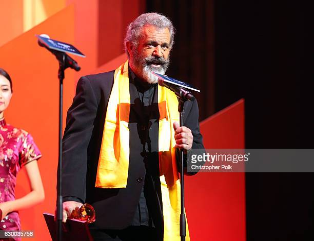 Mel Gibson accepts an award onstage during the 21st Annual Huading Global Film Awards at The Theatre at Ace Hotel on December 15 2016 in Los Angeles...