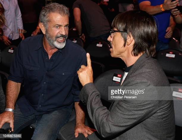 Mel Gibson and Anthony Kiedis of the Red Hot Chili Peppers attend the UFC 229 event inside TMobile Arena on October 6 2018 in Las Vegas Nevada