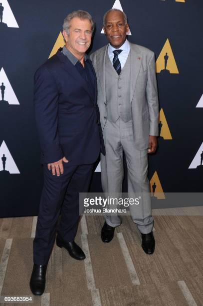 Mel Gibson and Danny Glover arrive at The Academy Celebrates Filmmaker Richard Donner at Samuel Goldwyn Theater on June 7 2017 in Beverly Hills...