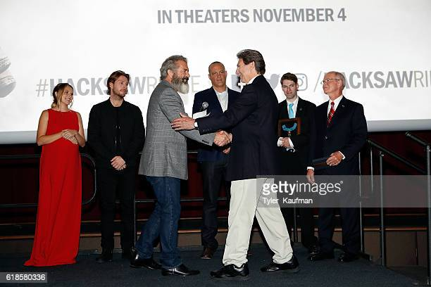 Mel Gibson and Desmond Doss Jr attend the Hacksaw Ridge special screening at the National World War II Museum on October 26 2016 in New Orleans...